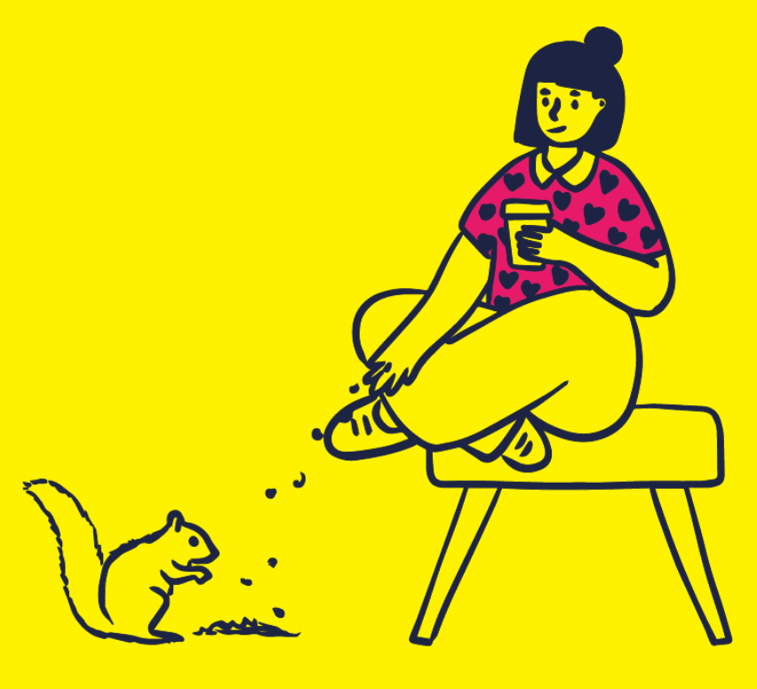 A person sitting on a still, drinking a take away coffee and feeding a squirrel